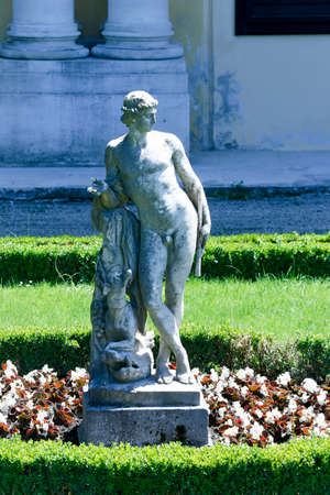 Statue in Great Parterre garden on Schonbrunn Palace in Vienna, Austria
