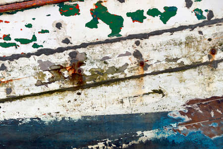 painted wood: Colored wood background of fishing boat. Stock Photo