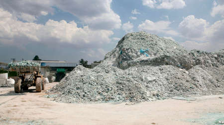 industrial storage of broken laminated glass windshields to recycling
