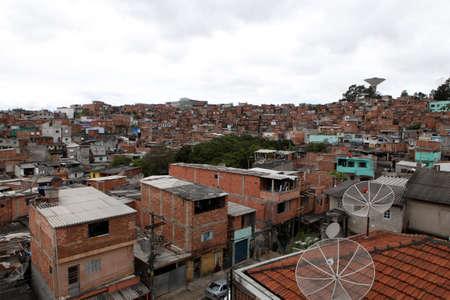 Shacks in the favela, Illegal and fragile constructions, neighborhood in Sao Paulo, brazil. 免版税图像