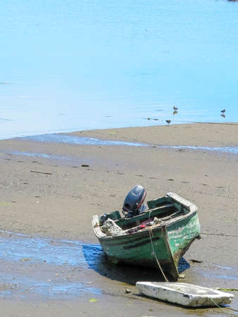 boat on beach of Castro, is the capital of the province of Chiloe, located south of Chile. On the east coast, is home to almost the entire population of the commune Stock Photo