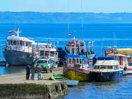 view of boat on sea in coast of Castro, is the capital of the province of Chiloe, Patagonia, Chile.  Editorial