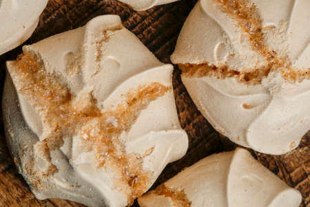 Traditional latin american dessert called suspiro or meringue. On wooden table Stock Photo