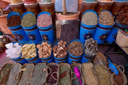 Colorful spices and herbs being sold on street stal at Morocco traditional market.