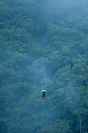 activity of tirolean over the mountain and forest with mist, in countryside of Brazil
