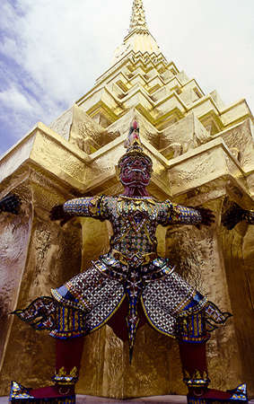 devil around the stupa in the royal palace in Bangkok photo
