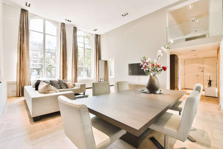 Modern dining room in a luxury house with individual design Foto de archivo