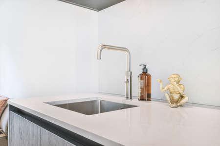 Close up of elegant sink in luxury kitchen Stock Photo