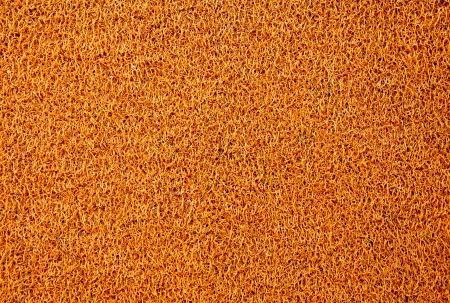 Texture background of the yellow plastic doormat. photo