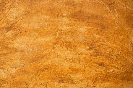 オレンジ色の壁の質感とセメントの背景