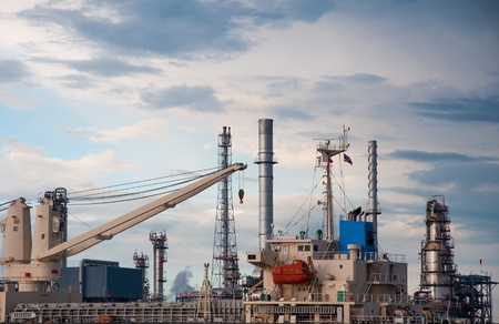 chemical engineering: crane on Boat at Oil refinery factory in Thailand.