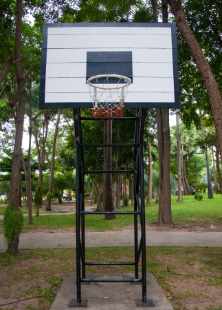 grunge basketball hoop in public park. photo