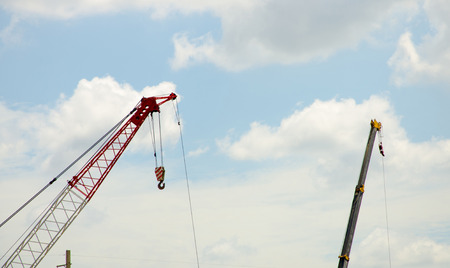 Crane and workers at construction site. photo