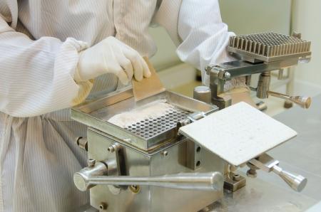 pharmacist preparing medication with packaging capsule. Archivio Fotografico