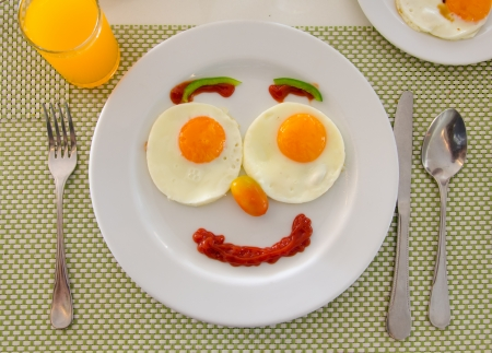 Happy Face Frying Eggs breakfast. Reklamní fotografie