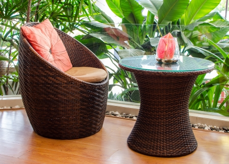 Rattan armchair furniture. Interior of a living room. photo