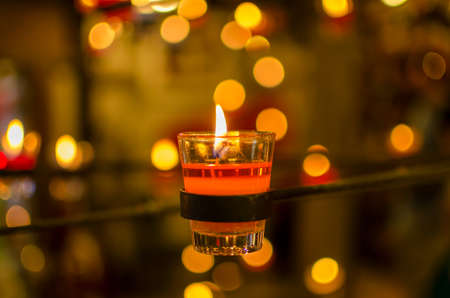 burning candles bokeh blured background photo