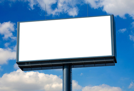 Blank billboard ready for new advertisement and blue sky.