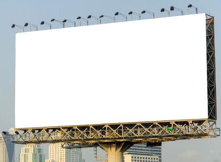 large blank billboard with city view background.