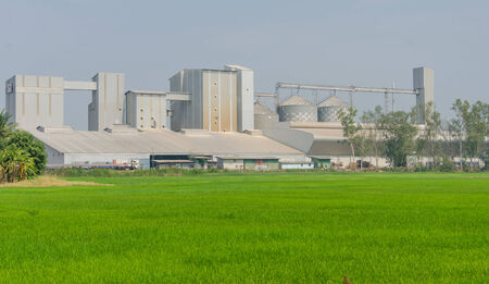 storage tanks in rice mill, factory process production line in thailand.