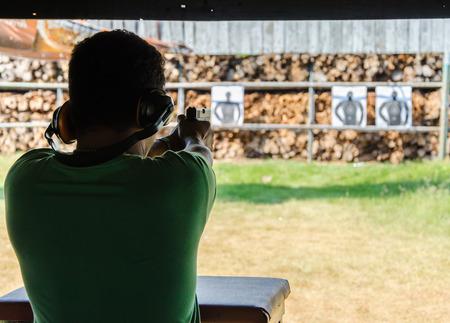 casings: Outdoor gun shooting of target range. Stock Photo