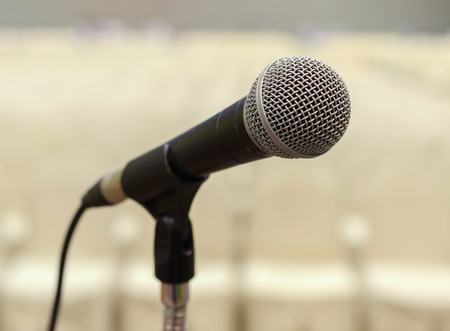 Close up of microphone in conference hall. photo