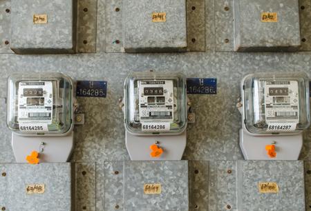 Watt hour Electric meter measurement tool at apartment. Editorial