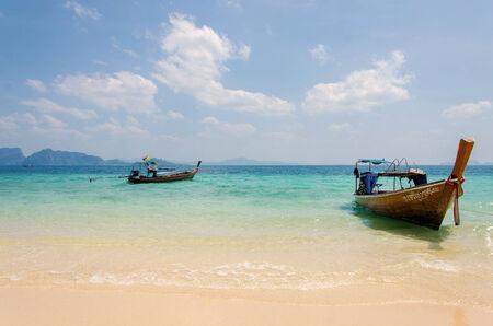 southern thailand: long tail boats in Tropical beach, Andaman Sea.