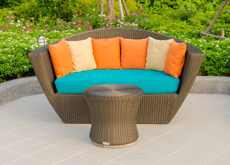 Rattan armchair furniture in garden. photo