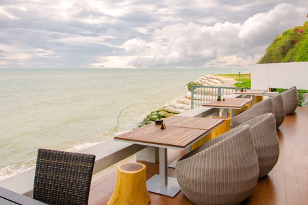 Rattan chairs and table on the beach.