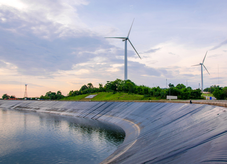 wind turbine generating electricity on dam catchment. photo