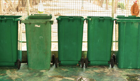 overfilled: overfilled trash of large bins for rubbish, recycling and garden waste.