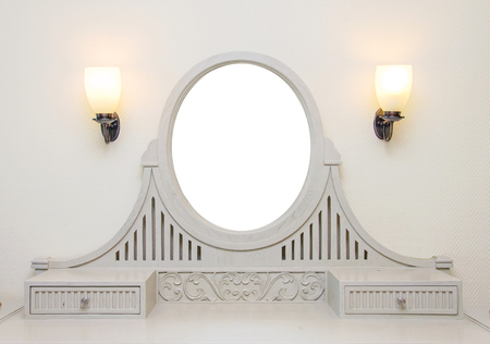 dressing table: wooden carved dressing table with blank frame in room. Stock Photo