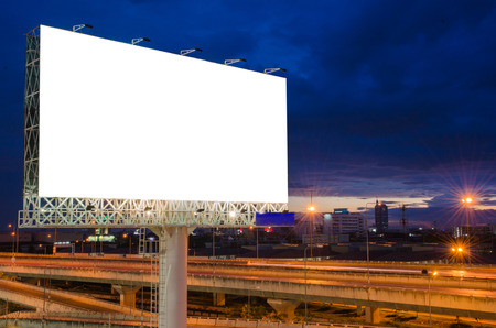 Blank billboard at twilight time for advertisement. photo