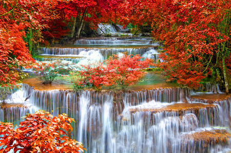 jungle green: Waterfall in deep rain forest jungle. (Huay Mae Kamin Waterfall in Kanchanaburi Province, Thailand) Stock Photo