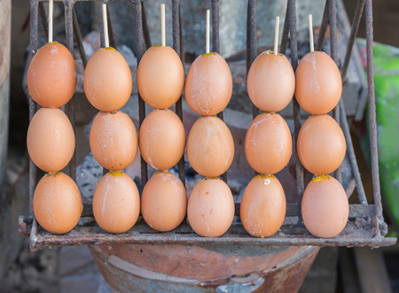 warm things: grill eggs at market, Street food at thailand.