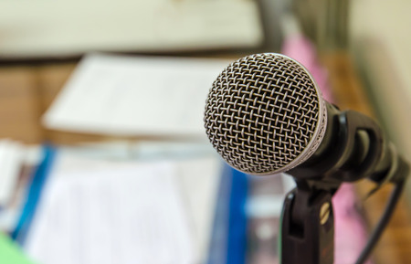 Close up of microphone in meeting room. Stock Photo