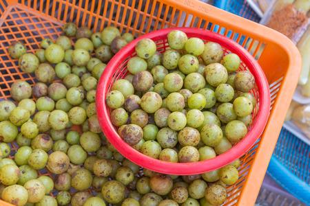 formulation: Fresh Indian Gooseberry raw fruit in market.