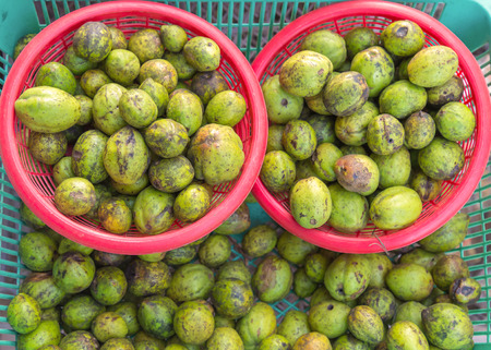 myrobalan: Myrabolan Wood (Terminalia bellirica) herbs in Thailand market.
