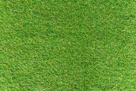 Artificial Green grass of texture for background.