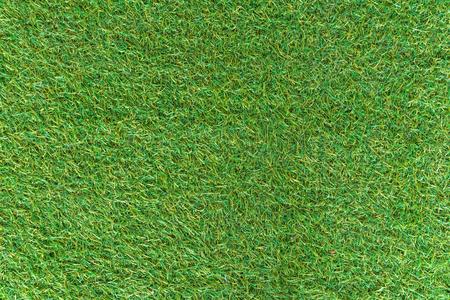 spuria: Erba artificiale verde di texture di sfondo. Archivio Fotografico