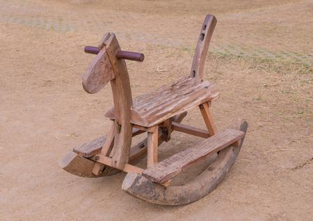rocking: Wooden Rocking Horse on playground Stock Photo