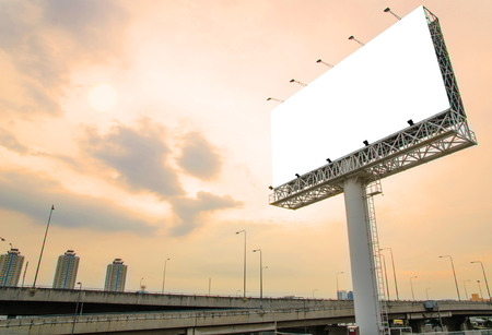 up: large blank billboard on road with city view background