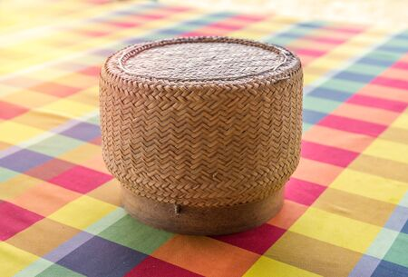 Thai sticky rice round box of handmade bamboo weaving. photo