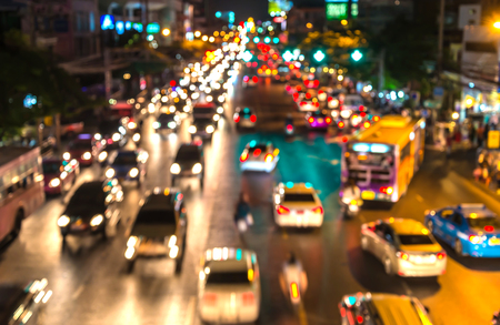 brake: abstact blur bokeh of Evening traffic jam on road in city