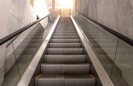 lift gate: escalators stairway inside modern office building. Stock Photo