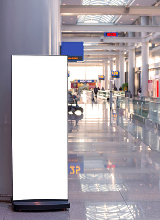 Blank billboard in modern interior hall at airport.