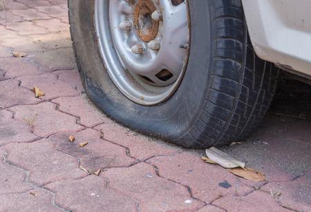 miry: Deflated damaged tyre on car wheel.