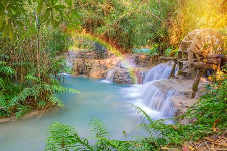 tat: Waterfall in rain forest wit rainbow (Tat Kuang Si Waterfalls at Luang prabang, Laos.)