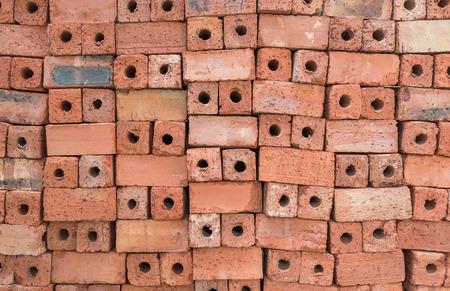 red clay: Red clay bricks for construction.